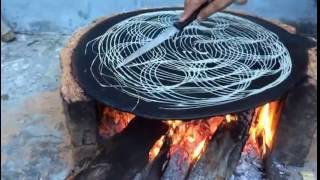 Cooking of special Monsoon roti  recipe  named as charolia in Jammu and Kashmir