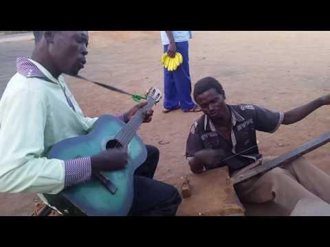 Malawi street musicians, MADALISO GROUP, sing a Chewa gospel song