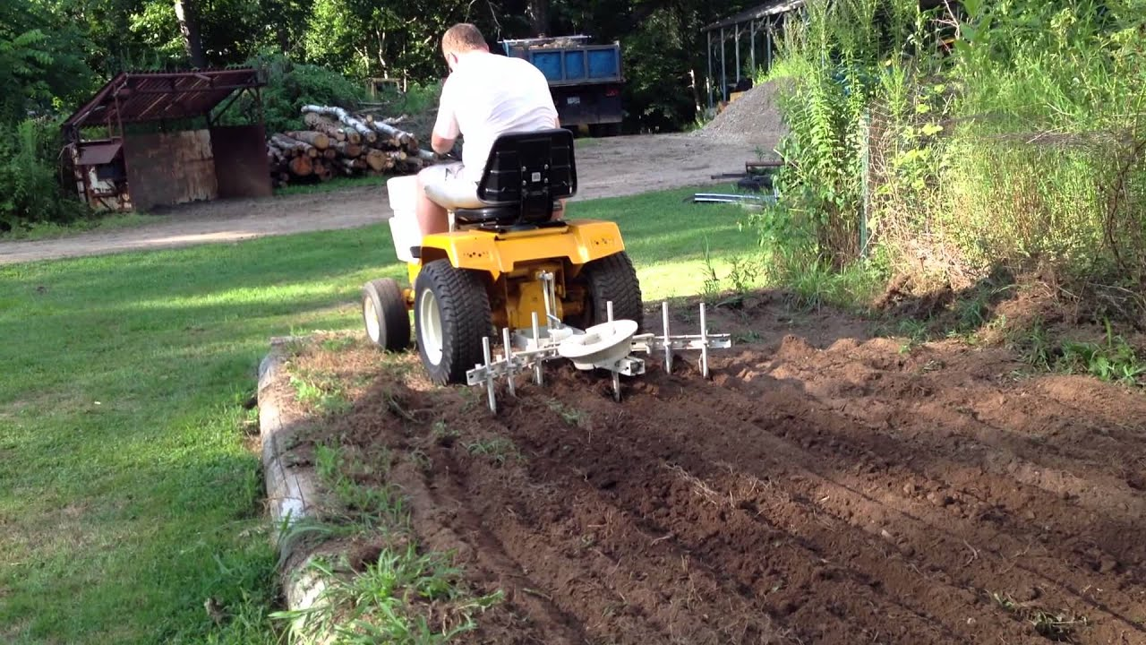 cub cadet 1450 in garden with cultivator YouTube