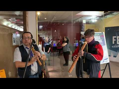 William Greenland and Jason Gresl play flutes in Centre Square Mall.