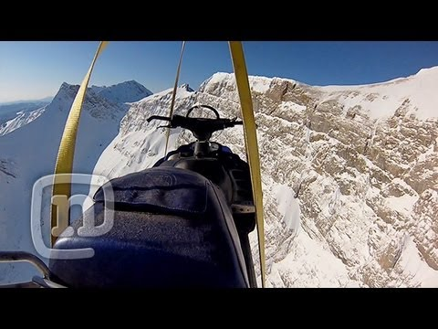 GoPro Erik Roners Foot Cliff Snowmobile BASE Jump YouTube - This is what happens when you fly a snowmobile off a cliff