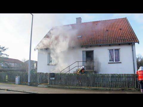Beboere anholdt efter påsat brand i hus