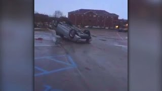 Deadly tornado flips cars and damages buildings