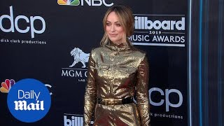 Olivia Wilde attends the 2019 Billboard Music Awards in gold