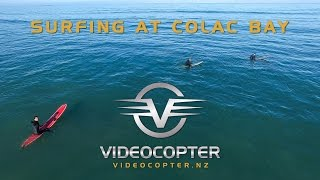 Surfing at Colac Bay in Southland