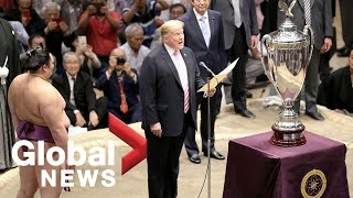 Trump plays round of golf with Abe, becomes first U.S. president to watch sumo wrestling in Japan