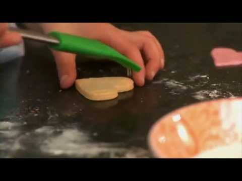 Cookie recipes for kids - How to make heart shaped cookies with Flossie Crums: http://www.flossiecrums.com Cookie recipes for kids - Flossie Crums show you how to make heart-shaped cookies using Renshaw's coloured sugar-dough icing.