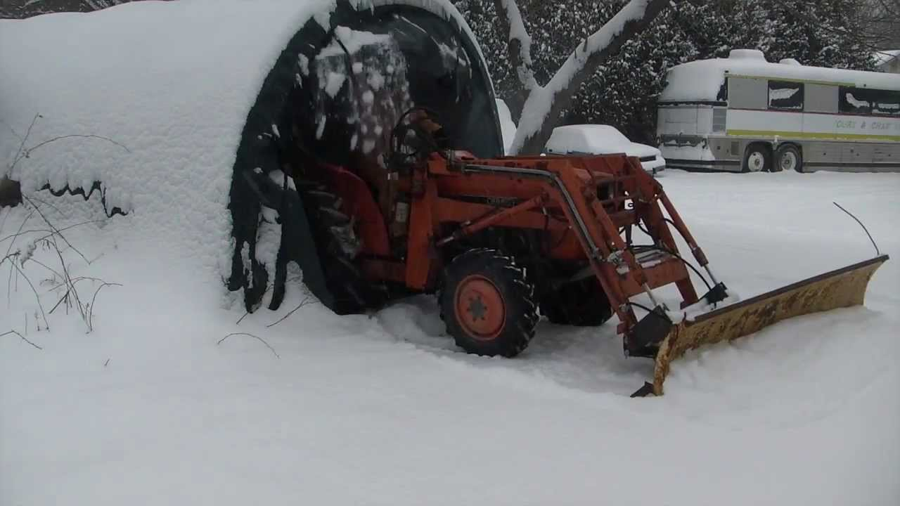 Plowing with the Homemade tractor snow plow mount YouTube