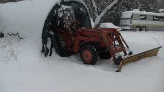 Plowing with the Homemade tractor snow plow mount