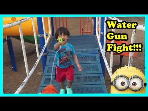 Water Gun Fight Hide N Seek  Playtime at the Park with Minions Kids Video  Ryan ToysReview