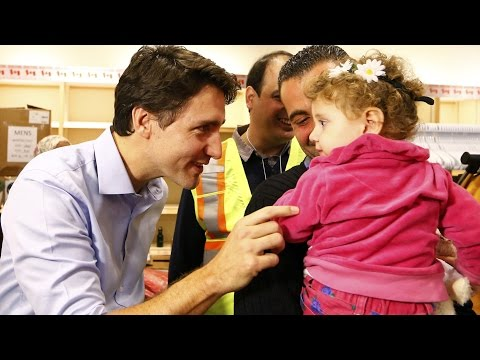 Canada's Prime Minister Justin Trudeau Greets Syrian Refugees Who Just Arrived In Toronto