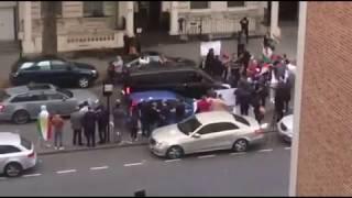 Kurdish Protesters Stamp On Iraqi Flag Taken From London Embassy