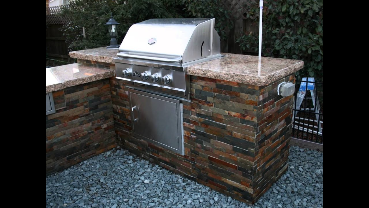 bbq island with custom granite countertop tile sides