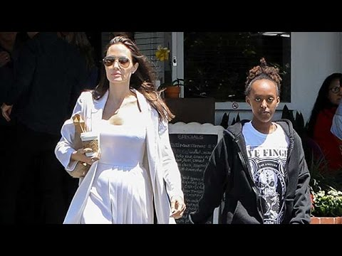 Angelina Jolie In White For Shopping With Pax And Zahara