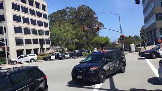 Evacuees File Out of YouTube Office Building with Hands Over Heads