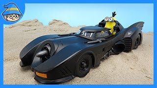 Minions are riding Batman BatCars. Minions became a superhero.