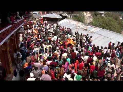 Large crowds at a procession for Goddess Ganga