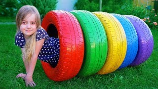 Funny kids play  with tires
