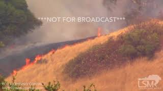 STOCK - 10-10-2017 Green Valley, CA Wildfire helicopters dumping and fire in trees