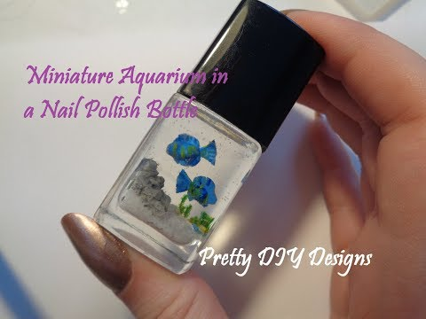 Miniature Aquarium with Blue Fishes in a Nail Polish Bottle