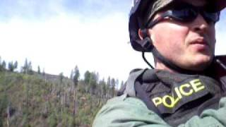 Police helicopter STABO lift from forest