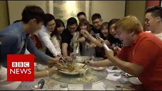 Chinese New Year food: How to get rich tossing fish - BBC News