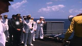 An officer on the flight deck briefs US Navy General Lyman L. Lemnitzer and other...HD Stock Footage