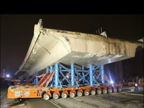 3,050-tonne bridge section moved 35 m in 1 hour
