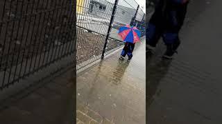 Its snowing...Using Umbrella..