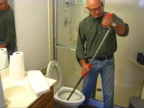 How to Clear a Toilet Clog using a Closet Auger - YouTube