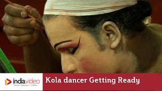 Kola dancer getting ready for Bhuta Kola in Kerala
