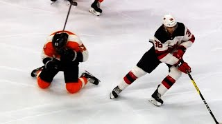Gostisbehere sells high stick penalty that never touched his face