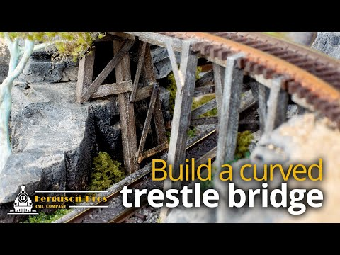 Build a curved trestle bridge over fake rocks on an N scale model railway