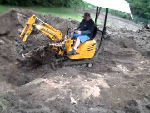JCB Micro Excavator Bob H Wrestling a Stump
