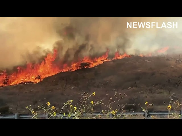 A Fire Started By A Burning Vehicle Spread Over 25 Acres