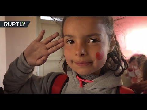 Russian and EU parliamentarians visit school in eastern Aleppo