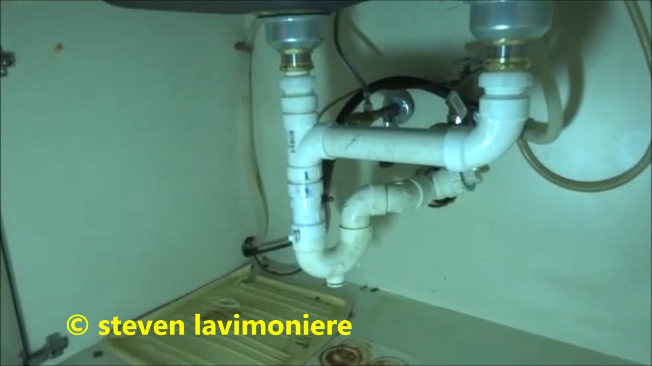 drain piping under kithen sink replaced ,snake drain - YouTube