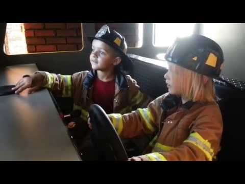Toren at the Glazer Children's Museum in Tampa - driving the fire engine