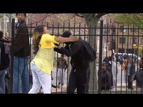 Angry Mom Beating Protester Son - YouTube