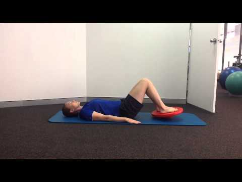 Bridge with wobble board for the glutes