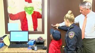 Boy calls 911 so Grinch won't steal his Christmas