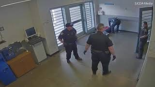 California Corrections Officer Punches Handcuffed and Hooded Man in the Head