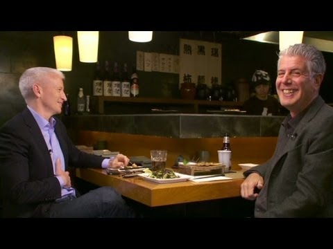 Anthony Bourdain pushes Anderson Cooper