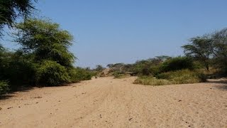 A normally dry river bed, Pukur, flows on the 5th of April in Samburu