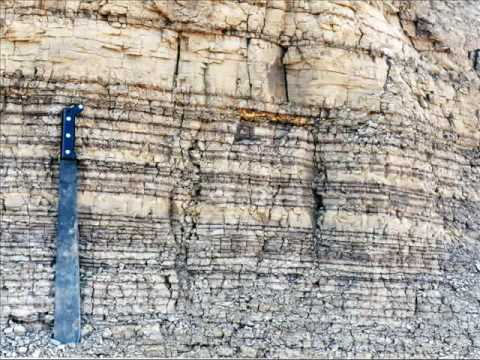 How are igneous rocks used in relative dating of rock layers in grand