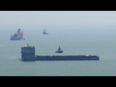South Korea tests raising of sunken ferry