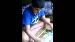 Autistic child solving a puzzle