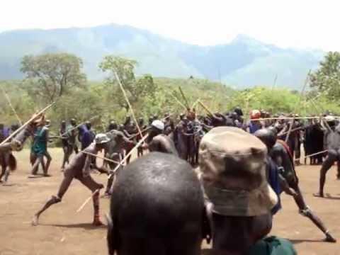 South Ethiopia : Upper Omo Valley / Suri tribe (aka Surma) tribal Donga Stick Fighting Ceremony