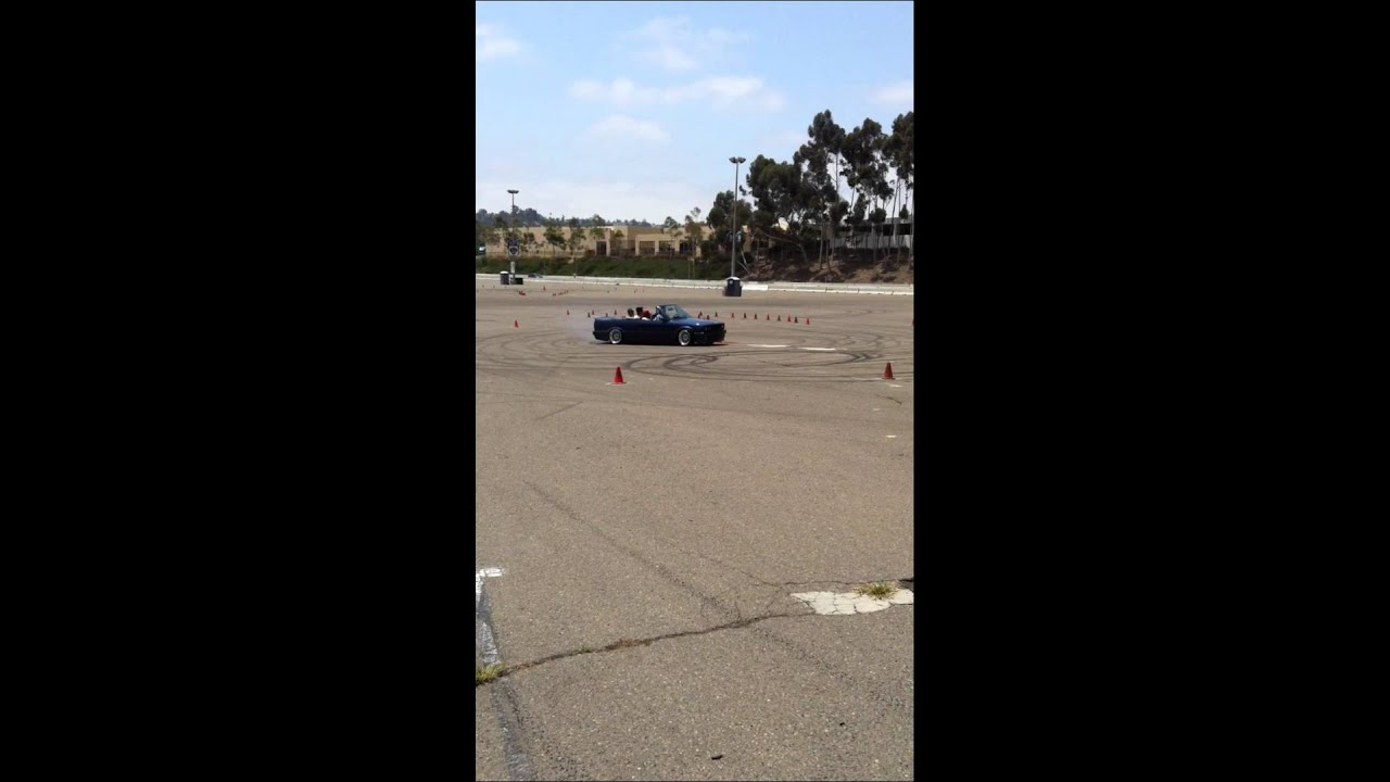 Blue Bmw Beamer M3 Convertible With Three People Doing Donuts At San