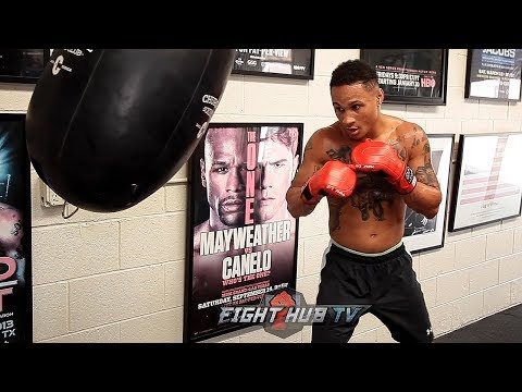 REGIS PROGRAIS SHOWS YOU PROPER BOXING HEAD MOVEMENT WHILE HITTING THE HEAVY BAG